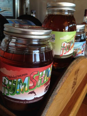 """Wicked Dolphin Artisan Rum also produces three types of """"rumshine,"""" which is the rum infused with ingredients such as strawberries placed right into the jar."""
