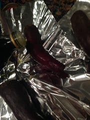 Scrubbed and trimmed beets are drizzled with olive oil, then roasted