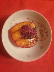 Grilled Florida peach with blackberry basil butter