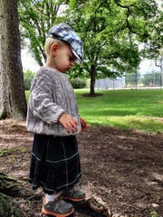 Part of the honored Clan MacKenzie, Bret Asmussen, 2, of Great Falls explores the grounds of the Daly Mansion in Hamilton during the Bitterroot Celtic Games and Gathering. He loves the bagpipes, his mom, Britney Asmussen, said.