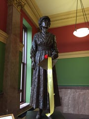The statue of Jeannette Rankin was decorated with a suffrage sash for the celebration of 100 years of women's suffrage in Montana.