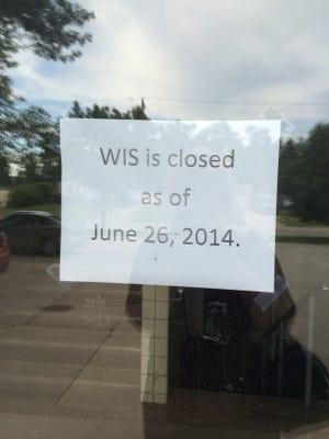 A sign on the door of the Wisconsin International School in De Pere on Thursday.