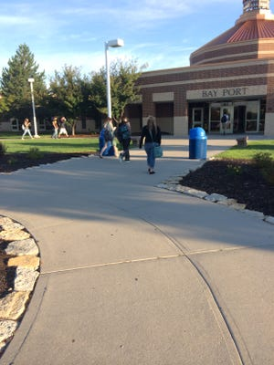 Students head into Bay Port High School in Suamico Tuesday for the first day of school. Patti Zarling photo.