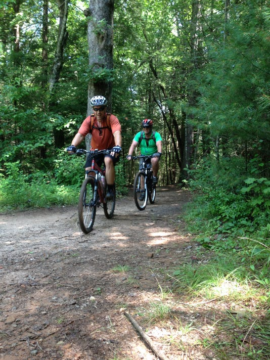 8_3_14_20Mountain_20bikers_20finish_20up_20on_20the_20Reasonover_20Creek_20T.jpg