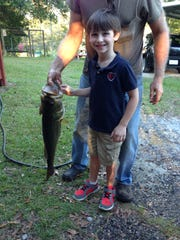 """While fishing at his """"Paw Paw"""" Grady Lee's pond in"""