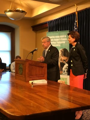 Terry Branstad answers questions from the media at his weekly press conference.