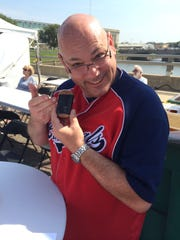 Tim Tungett of Des Moines, modeling his Spam Musubi from Hawaiian Grill.