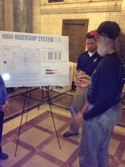 An IndyGo rider looks over an exhibit at a town hall meeting on Thursday, Sept. 18, 2014, about future bus service. Two more meetings will be held on Friday at The Hall, 2002 N. Alabama St. — from 9 a.m. to 11 a.m. and from 4 to 6 p.m.