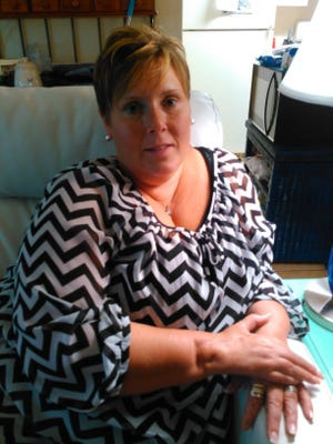 Jennifer Plank-Greer, 38, lost the full function of her right hand after it was nearly severed while she was watching the explosion of a target two years ago. She has filed a civil suit against the manufacturer and distributor of the explosive materials as well as other parties.