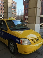 An Indianapolis cab waits for passengers outside of