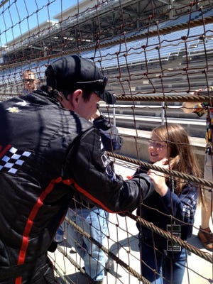 IndyCar driver Buddy Lazier is pictured with daughter Jacqueline. The 12-year-old was born with a rare disorder called aniridia, which is among the inherited eye diseases being researched at UI's newly established Wynn Institute.