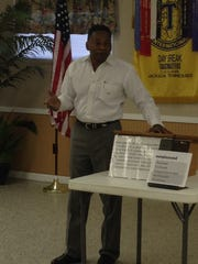 Sidney Wilson gives his introductory speech at a recent Daybreak Toastmasters meeting.