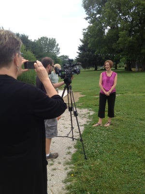 Story behind the story: Carrie Lambert, executive director of the Indiana Tourism Association, talks with WLFI's Jamie Long, as Jo Wade, executive director of Visit Lafayette-West Lafayette, snaps a photo. Lambert was at Wolf Park recently to talk about tourism in the state.