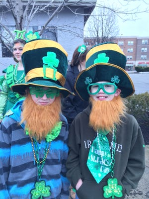 Cousins Evan Lewellen (left) and Jacob Lewellen waited for the parade to begin on Saturday, March 14, 2015, in West Lafayette.