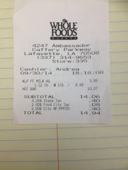 A receipt from Whole Foods Market shows a breakdown of sales taxes.
