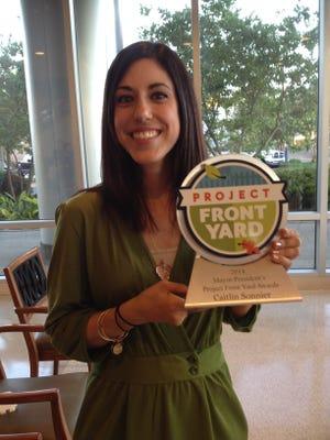 Caitllin Sonnier, winner of a Best Of Mayor-President's Front Yard Award.