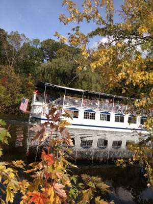 The Grand Princess riverboat glides along the Grand River on Friday at the Grand Ledge Color Cruise and Island Festival.
