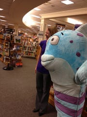 Grand Ledge author Deborah Diesen meets her character, Mr. Fish, during a reading and pajama party event at Schuler Books and Music at Meridian Mall.