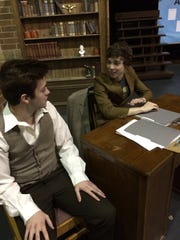 "Williamston High students Josh Delany (left) and Jared Ross are shown preparing for ""David and Lisa."""