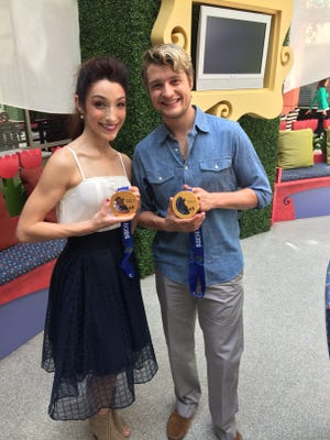 Olympic gold medalists and two-time world champions Meryl Davis and Charlie White showed off their medals and visited patients Wednesday at Beaumont Children's Hospital.