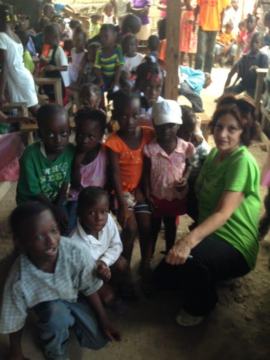 Joan Haber with Haitian Children.JPG