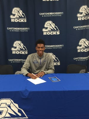 Salem senior Allante Wheeler is happy about signing to play college basketball at Delta.