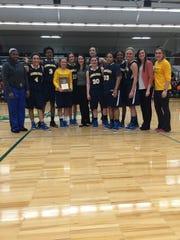 Schoolcraft College's women's basketball team celebrates