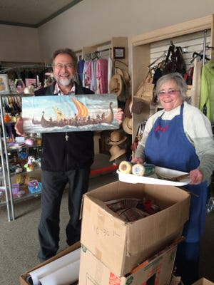 Erik Cuolahan of Northville was glad to donate his late mother's goods to the Presbyterian Thrift Shop, getting help from volunteer Carolyn Setty of Livonia.