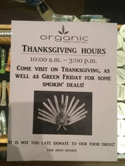 "A sign on the counter of the Fort Collins, Colo. marijuana store Organic Alternatives advertises the upcoming Thanksgiving and ""Green Friday"" sales."