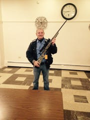 Claude Siragusa shows the Savage 30.06 that he took for first place at Buck Fever Night 2014. Buck Fever Night proceeds go to classroom needs for hunter safety programs throughout Manitowoc County.