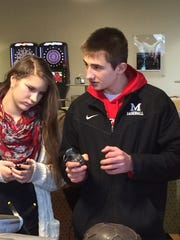 Lincoln High School students Madelyn Gintner and Nick Strzyzewski examine a replica WWII gernade on display during a presentation by veterans Dec. 2 at Concordia University Wisconsin in Mequon. The history students heard stories from WWII, Korean War, and Vietnam War veterans during the presentation.