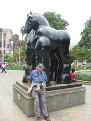 Writer and photographer Pattison has his photo taken at a statue by Botero, a legendary living artist who prefers a bulbous style.