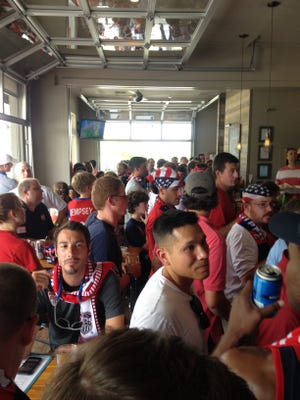 Fans congregated at The Tipping Point, a local bar, Tuesday to watch the U.S. play Belgium in a World Cup elimination match. The U.S. lost 2-1 in extra time.