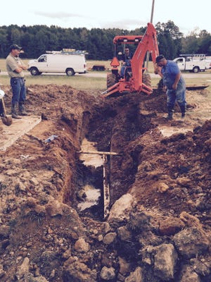 Elmore County Public Schools maintenance workers make repairs to a water feed line Monday morning. The repairs should be complete by afternoon, said Judy Caton, a school system spokesperson.