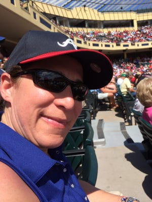 Ambra Offutt, now an executive with Longhorn Steakhouse, remains enthusiastic about baseball by going to Atlanta Braves games.