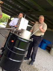 Sgt. Keith Bean and Sumner County Sheriff Sonny Weatherford demonstrate the department's recently acquired portable incinerator for unused and wanted prescription medication.