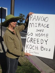 Aletha Stuart is one of about a dozen demonstrators standing at the corner of Frank Sinatra Drive and Highway 111 protesting the Koch brothers' conference at the Ritz-Carlton in Rancho Mirage.