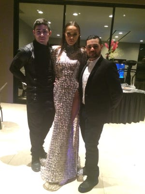From left to right, model Jesse Castell, model Eva Krasnova and fashion designer Michael Costello attended Thursday's Fashion Week El Paseo kick off party in Rancho Mirage.