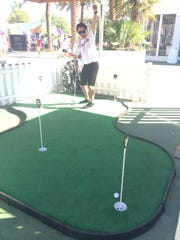 A putting green is set up at the Indian Wells Tennis Garden.