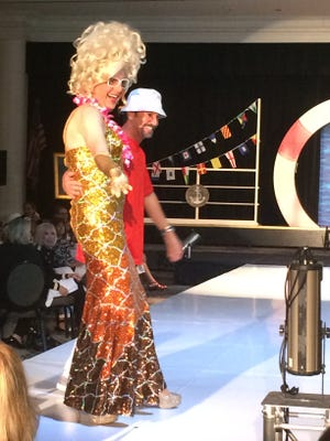 Bella da Ball walks the runway Friday for the annual Palm Springs Woman's Club fashion show luncheon at the Riviera Resort.