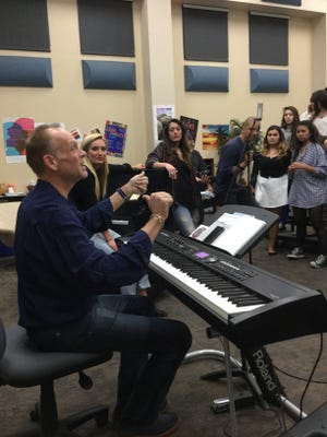 Rancho Mirage High School Choir Director Andy Eisenmann discusses music with students.