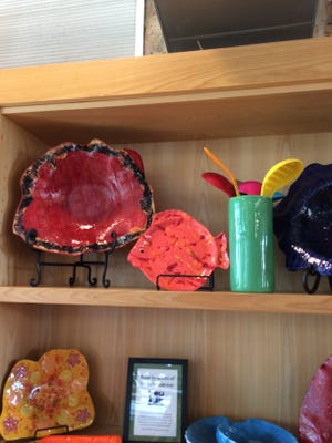 SoGourmet Pensacola is selling Arc Gateway Inc. artists works at its downtown store to help the organization. The art is made by includes bowls, plates and wine chillers.