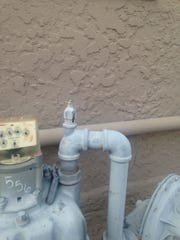 Phoenix firefighters discovered the three-foot continuous flame shooting out of the apartment's gas-line valve.