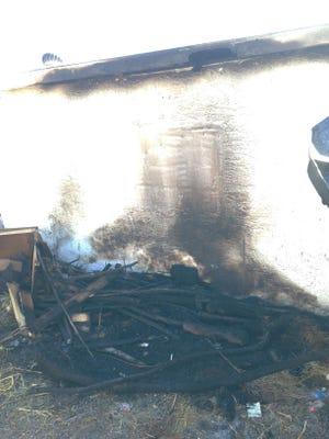 An alleyway fire in Phoenix on Oct. 13, 2014, burned a shed.