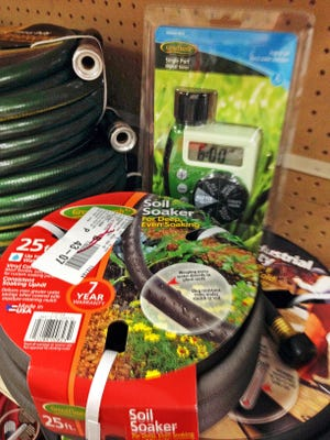 Timers and soaker hoses, which can be used to keep your garden healthy while you're on your vacation on display in a hardware store in Larchmont, New York in July 2014.