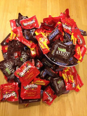 Candy purchased in anticipation of Halloween trick-or-treaters at his home in Milpitas, Calif. on Monday, Oct. 27, 2014.