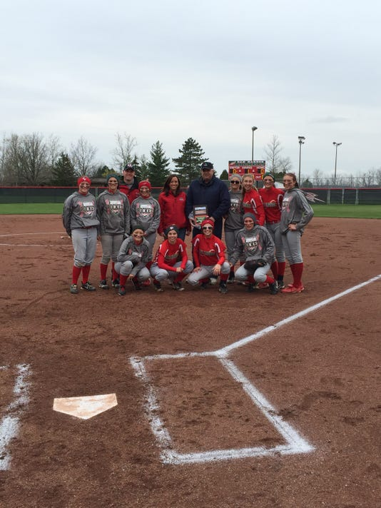 Oak Harbor's softball team with E.J. Croll.JPG