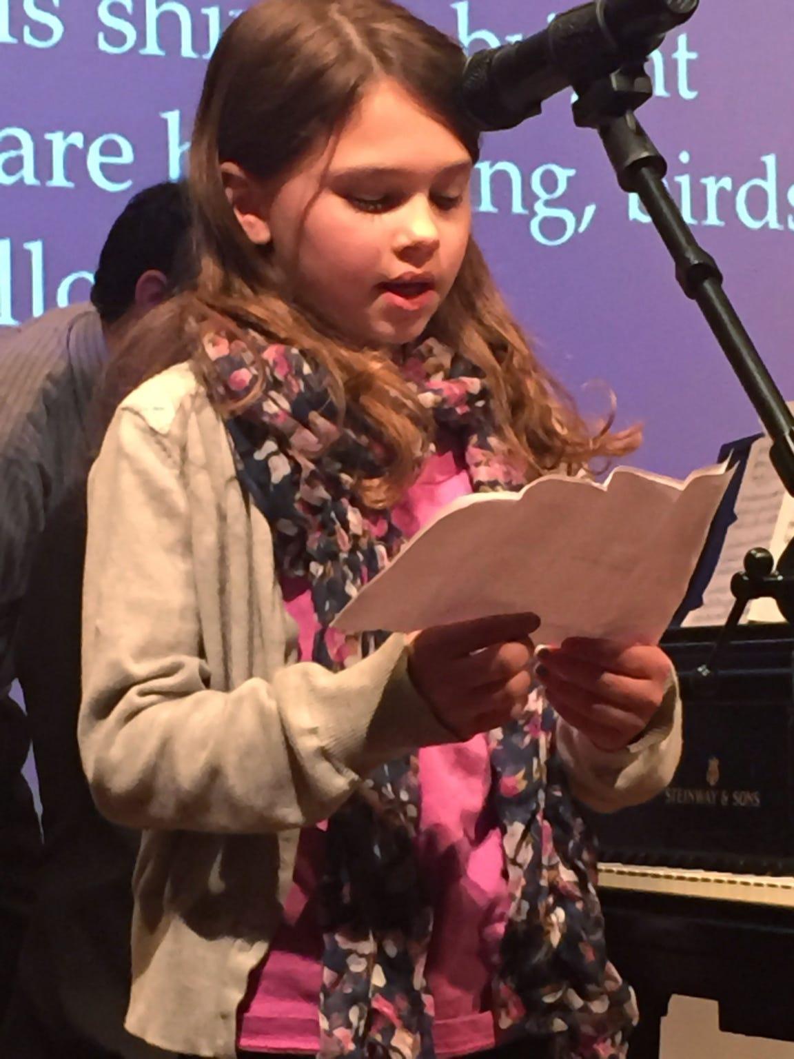 "Skyler Clark reads her poem, ""Come Follow Me,"" inspired"