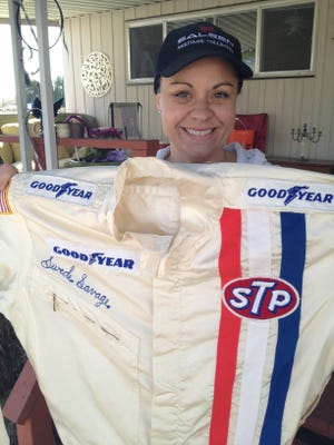 Angela Savage has saved one of the uniforms her father, Swede, used in his driving career.