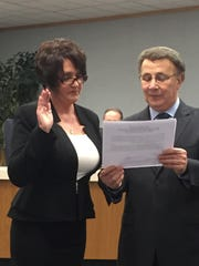Kim Codispoti takes the oath of office Wednesday evening